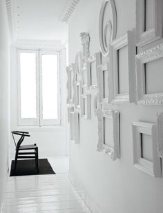 Such an easy and simple #craft project idea: old ornate picture #frames painted #white, hung in a group formation. Make a plain #wall not so plain anymore!