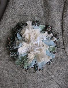 would be a pretty brooch or could put on a belt: http://mollychicken.blogs.com/my_weblog/2006/10/raggy_flowers.html