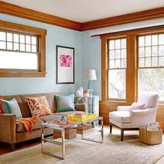blue painted walls wood trim windows bhg  For those of you living in homes with wood window casings and door trim, take a step back and resist the urge to coat them in paint. Preserve their integrity and add color to the walls instead.