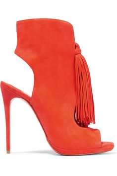 Christian Louboutin's 'Ottoka' sandals have playful tassels at the front that swish with each step. This Italian-made pair is crafted from orange suede with chic cutouts in an ankle boot-inspired silhouette. Style yours with LBDs and fluted skirts.