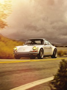 Porsche 911. Love the color schemes in the background, too. Great for traveling on road trips.