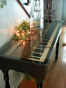 Old piano turned into a table,I LOVE THIS! So going to do it when I have a permanent home