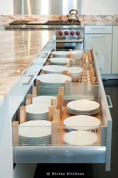 Instead of storing plates in upper cabinets, this kitchen from Divine Kitchens uses plate drawers with adjustable dividers. Fantastic Idea! Dish Storage, Plate Storage, Drawer Storage, Plate Organizer, China Storage, Cereal Storage, Drawer Dividers, Cutlery Storage, Flatware Organizer