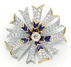 A DIAMOND, ENAMEL AND GOLD BROOCH, BY JEAN SCHLUMBERGER, TIFFANY & CO.   Designed as a stylized flower, set with a circular-cut diamond pistil, within a blue enamel and sculpted gold surround, extending circular-cut diamond petals, enhanced by gold trim, mounted in gold and platinum, circa 1955, in a Tiffany & Co. black suede case  Signed Schlumberger for Jean Schlumberger, Tiffany