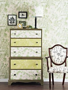 I love the paper lining the drawer fronts of this dresser.  I would put a tall dresser like this in my entry to hold off season garb.  Love the matching lampshade, too!