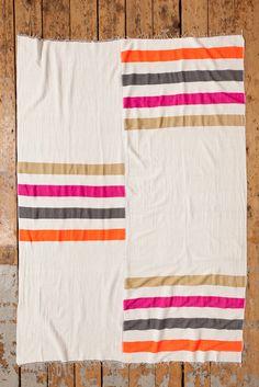Orange, grey, pink and tan striped Zoza Blanket // Made in Ethiopia // via Lemlem