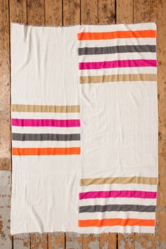 Orange, grey, pink and tan striped Zoza Blanket // Made in Ethiopia // via Lemlem