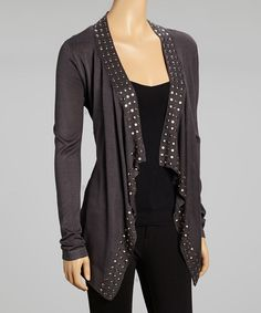 Experience on-trend style with this sleek cardigan. Flaunting a relaxed silhouette and silver studded details, it's sure to add edgy appeal to any chic ensemble.Measurements (size M): 32'' long from high point of shoulder to hem60% cotton / 40% viscoseHand wash; hang dryImported<...