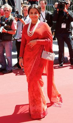 On the red carpet or wearing the red carpet? Though Vidya Balan looks graceful in the floral Sabyasachi number paired with the high-neck blouse and pearls, we're not too impressed with the choice of colour.  Cannes jury member Vidya Balan arrives for the screening of the film Un Chateau en Italie. (Reuters)