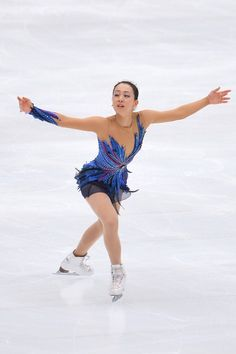 SAITAMA, JAPAN - OCTOBER 05:  Mao Asada of Japan performs during the Japan Open 2013 Figure Skating at Saitama Super Arena on October 5, 201...