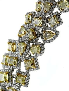 34 Carats of  Fancy Intense Yellow Diamonds White Gold Bracelet | From a unique collection of vintage modern bracelets at http://www.1stdibs.com/jewelry/bracelets/modern-bracelets/