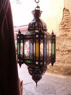Large traditional moroccan outdoor/indoor lantern with embossed colored glass panels with exquisite hand carved designs. All handmade & imported from Morocco. Moroccan Art, Moroccan Lanterns, Modern Moroccan, Moroccan Interiors, Moroccan Design, Moroccan Style, Colorful Interiors, Indoor Lanterns, Wall Tiles Design