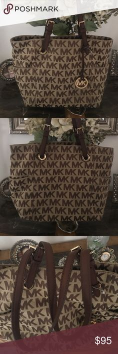 MICHAEL KORS SIGNATURE EAST WEST SIGNATURE TOTE MICHAEL KORS SIGNATURE TOTE.  Beige, Ebony, Mocha. 3 compartments inside, one center zipper compartment.  Outside of the bag has pockets. Gently used. All hardware & straps are in excellent condition. The Inside has a spot on the bottom (pic 7)  Front of the bag on the bottom left & right corners show very little wear, not noticeable, but must state (pic #6 & 8) Questions welcomed. Michael Kors Bags Totes