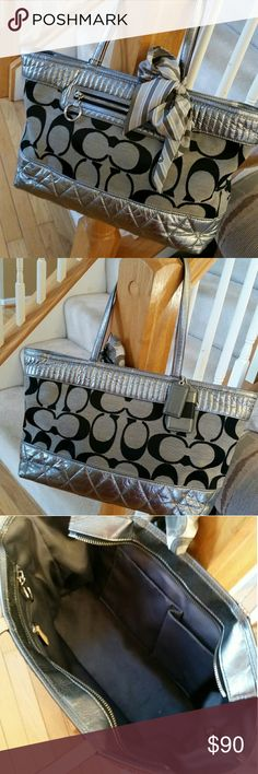 """Coach Poppy quilted handbag This super cute, classy Coach bag is black and silver with a quilted accent look. Zipper at top will open completely to a great size bag with inside zipped pouch and two side pockets. Shoulder straps measure 9"""" long. The bag is 17""""x9.5"""", about 4.5"""" wide at bottom. Inside fabric silver. Bag still in great condition. Comes with silver/gray Coach scarf. Price is firm. Serial #G1176-18676 Coach Bags Shoulder Bags"""