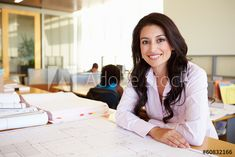 Female Architect Studying Plans In Office - Buy this stock photo and explore similar images at Adobe Stock - Female Architect Studying Plans In Office – Buy this stock photo and explore similar images at Ad -