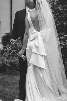 Back view of a silk wedding dress with a low back and a big bow Bow Back, Big Bows, Silk, Wedding Dresses, Fashion, Bride Dresses, Moda, Bridal Gowns, Fashion Styles