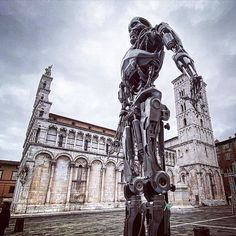 A thing I love about @luccacomicsandgames taking place now until 3 November in the Tuscan city of Lucca is that it proves that Italy is more than just a lot of old ruins and churches. Though I love how this cyborg is juxtaposed here against the 14C façade of the church of San Michele in Foro Lucca Comics is the second largest celebration of its kind in the world and the largest in Europe. @thelazydesigner #italynews #tuscany #luccacg19 Italy News, Lucca, Tuscany, Florence, Statue Of Liberty, Facade, Two By Two, Celebration, November