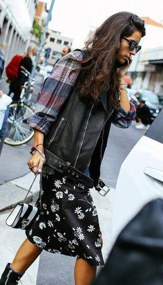 *Inspo* Leather vest, Plaid shirt, Floral skirt, Boots, Chain strap purse, Sunglasses, and Delicate stacked bracelets