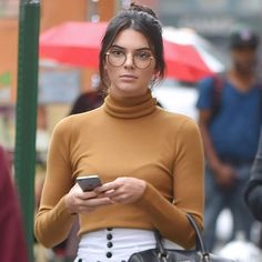 Kendall Jenner makes a case for the geek-chic trend in thin, round glasses.