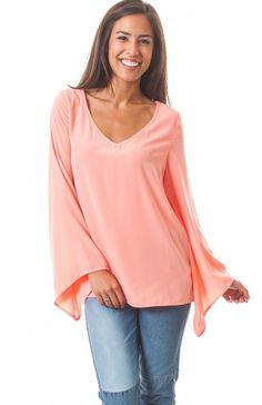 V-neck long asymmetrical bell sleeve top featuring back v-neckline with strap. Such a beautiful top that looks great over any type of bottoms. $13.75