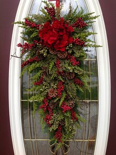 "Christmas Wreath Winter Wreath Holiday Vertical Teardrop Swag Door Decor..""Seasons Greetings"" Red w/ Green via Etsy."