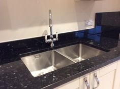 The Bluci double bowl undermounted kitchen sink. Set into granite with a single tap hole. A super practical sink with deep twin bowls. Thanks to our customer for sending this into us. Sink Taps, Sinks, Designer Kitchen Taps, Spray Insulation, Double Bowl Kitchen Sink, Real Kitchen, Waste Disposal, Corian, Granite