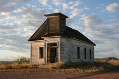 """""""A old abandoned church on US Hwy 84 in New Mexico. It's between Ft. Sumner and Clovis on the northside of the road. It sits back about 75 yards from the road hidden in mesquite bushes."""