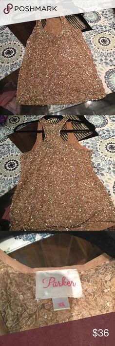Gold Parker sequin top All gold everything! Amazing top! Some beads have started to come off only in one section, the rest is perfect. Only coming off right where arm will hang so this is not noticeable. Tag reads extra small but fits up to size medium. I can wear it at size 4 /34C Parker Tops Tank Tops