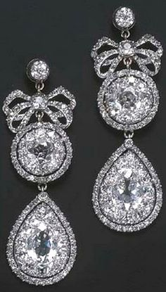 A PAIR OF VERY FINE 18TH CENTURY DIAMOND EARRINGS Each designed as a detachable drop-shaped cluster pendant to the diamond bow, cluster and collet top, mounted in silver, circa 1770, 6.0 cm. long.