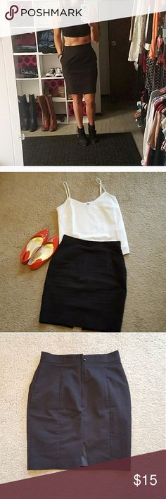 """H&M High Waisted Black Pencil Skirt sz 8 High waist black pencil skirt with pockets and a slit in the back of the skirt. Skirt is lined and has a zipper and hook and eye closure on the back. Skirt is in LIKE NEW and no flaws.   High waisted.   Width across waistband: 13."""" Length: 19.5""""  Model info : 133 lbs size 6 and 5'5"""" tall. H&M Skirts Pencil"""