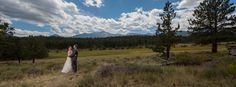 Rocky Mountain National Park Wedding Bride and Groom Embracing in Field