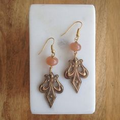 Peach Moonstone Fleur de Lis Earrings – Laura James Jewelry