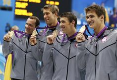 (L-R) Brendan Hansen, Matthew Grevers, Michael Phelps and Nathan Adrian of the U.S. pose with their gold medals after winning the men's 4x100m medley relay final during the London 2012 Olympic Games at the Aquatics Centre August 4, 2012. REUTERS/Jorge Silva