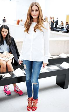 Olivia Palermo in a white button-down blouse, ripped skinny jeans, and red strappy heels