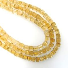 Citrine - Natural - 8x8mm Faceted Trillion Tube