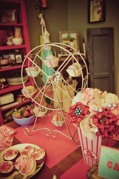 fill ferris wheel with sweets instead of cupcakes. Also has great photobooth idea