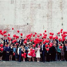 Beautiful idea for all wedding guests to release love balloons after ceremony