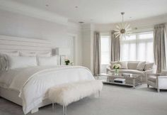 Stunning Cozy all white bedroom decor with channel tufted bed and white curved sofa