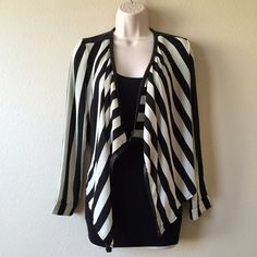 Black & White Draped Blazer Excellent used condition, like new! Thin long sleeve drape blazer. Faux leather shoulders, silvery gold zipper details. Black and white vertical stripes make you look slimmer! Perfect cinched, fitted look. Long in the front, short in the back. Wear it over your favorite bodycon dress! Great for girls night out or date night! Tag is a size medium, but fits more like a small. REPOSH. Jackets & Coats Blazers