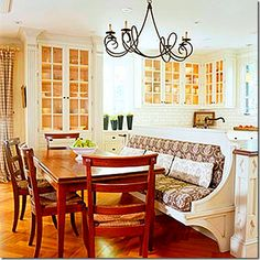 Banquette at the end of an island allows more room for a table in smaller spaces.  You don't need a separate breakfast room.