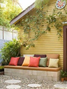 DIY a Seating Area Furniture can be an expensive investment for backyards, but there are options for make-it-yourself benches, chairs, and tables. Here, low-cost concrete blocks, dry-stacked and covered with a foam pad, offer lots of seating in a high-traffic spot outside the home's back door.