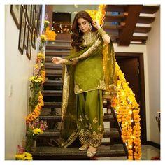 channels her inner beauty in a deep hued green traditional Mayun look adorned with gotta. Pakistani Mehndi Dress, Asian Wedding Dress Pakistani, Pakistani Fashion Party Wear, Pakistani Formal Dresses, Beautiful Pakistani Dresses, Indian Fashion Dresses, Pakistani Dress Design, Pakistani Outfits, Ethnic Fashion
