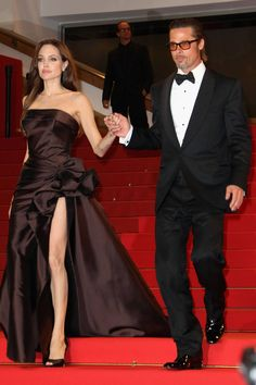 Angelina Jolie and Brad Pitt leave The Tree of Life premiere during the 64th Annual Cannes Film Festival on May 16, 2011, in Cannes, France. Getty -Cosmopolitan.com
