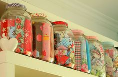 Fabric Storage.  I do this a lot.  Different jars have 1 basic color in it.  1 has flannel, children's prints, and etc. - makes colorful decor, too