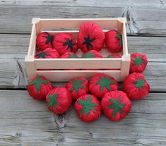 Full-sized tomato, sewn of red polyester satin and green felt, filled with antialergic polyfill. In my shop you can buy wooden box too.  There are full-sized tomatoes which - like the natural - differ a little in shape and size. These differences offer new ways of playing: a child can put them from the smallest to the biggest one (or vice-versa) and during playing store one can select size according to buyers request. Of course when the numbers of tomatoes is great it motivates for learning…