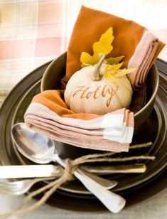 A mini pumpkin becomes an adorable place card. More ideas for decorating with mini pumpkins: http://www.midwestliving.com/homes/seasonal-decorating/how-to-decorate-with-mini-pumpkins/page/10/0