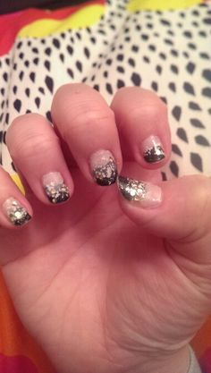 Nude overlayed black with white and gold glitter. Sponge application.