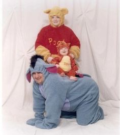 Um. Ok. This is so totally something I would have put my family thru! Thank goodness Rick would never have let me put him in an Eyore suit! We had  Pooh all over the place when Fran was a baby!  Bwahhahahah