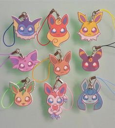 Cute little eeveelution charms! Attach them to your phone, Nintendo DS, bag, purse, keys, anywhere!  Charms are attached to a phone strap in a colour of your choice. Choose your colour from the selection in the pictures.  Each charm varies in size depending on the pokemon. The biggest, Flareon is approx 4.4 x 3cm, while the smallest, Umbreon is approx 3 x 3cm.  Designs have been drawn by myself, printed on quality shrink plastic, and sealed with UV, moisture resistant sealant. However…