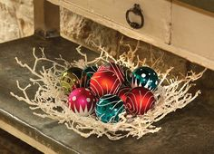 Fill #bowls or vases with colorful tree #ornaments, pinecones or fresh produce like pomegranates, artichokes, lemons, limes, oranges and apples. Throw in some candy canes, red and white chocolate mints and chocolate kisses for the sweet tooth folks. #Christmas #holiday #decor #housetrends